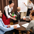 Waitress serving business conference room — Stock Photo