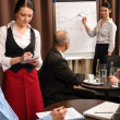 Waitress take order businesspeople conference room — Stock Photo #10220671