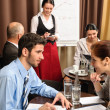 Businesspeople conference room waitress take order - Stock Photo