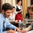 Business meeting dealing at restaurant — Stock Photo