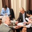 Business meeting executives dealing at restaurant - ストック写真
