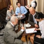 Business meeting executives dealing at restaurant — Stock Photo