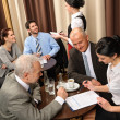 Stock Photo: Business meeting executives dealing at restaurant