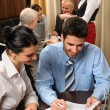 Business meeting young executives at restaurant — Stock Photo