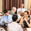 Business lunch executives look menu restaurant — Stock Photo