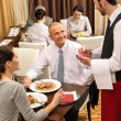 Business lunch waiter taking order at restaurant — 图库照片