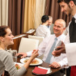 Business lunch waiter taking order at restaurant — Stok fotoğraf