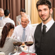 Waiter hold wine glasses business lunch restaurant - Foto Stock