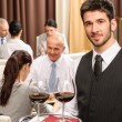 Waiter hold wine glasses business lunch restaurant - Stock Photo