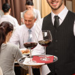 Waiter hold wine glasses business lunch restaurant — Stock Photo