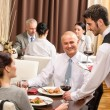 Business lunch waiter serving red wine — Stock Photo