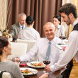 Business lunch waiter serving red wine — Stock Photo #10221119