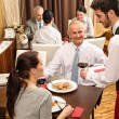 Business lunch waiter serving red wine — Stock Photo #10221127