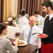 Business lunch executives toasting with red wine — Stock Photo