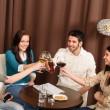 Happy friends enjoy drink at bar — Stock Photo