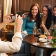 Friends at the bar man take picture — Stock Photo #10221274