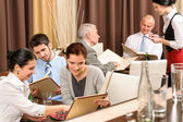 Business lunch executives looking menu restaurant — Stock Photo