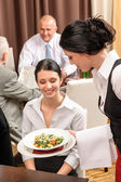 Business lunch restaurant waitress serving woman — Stock Photo