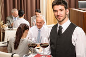 Waiter hold wine glasses business lunch restaurant — Stock Photo