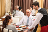 Business lunch waiter serving red wine — Foto Stock