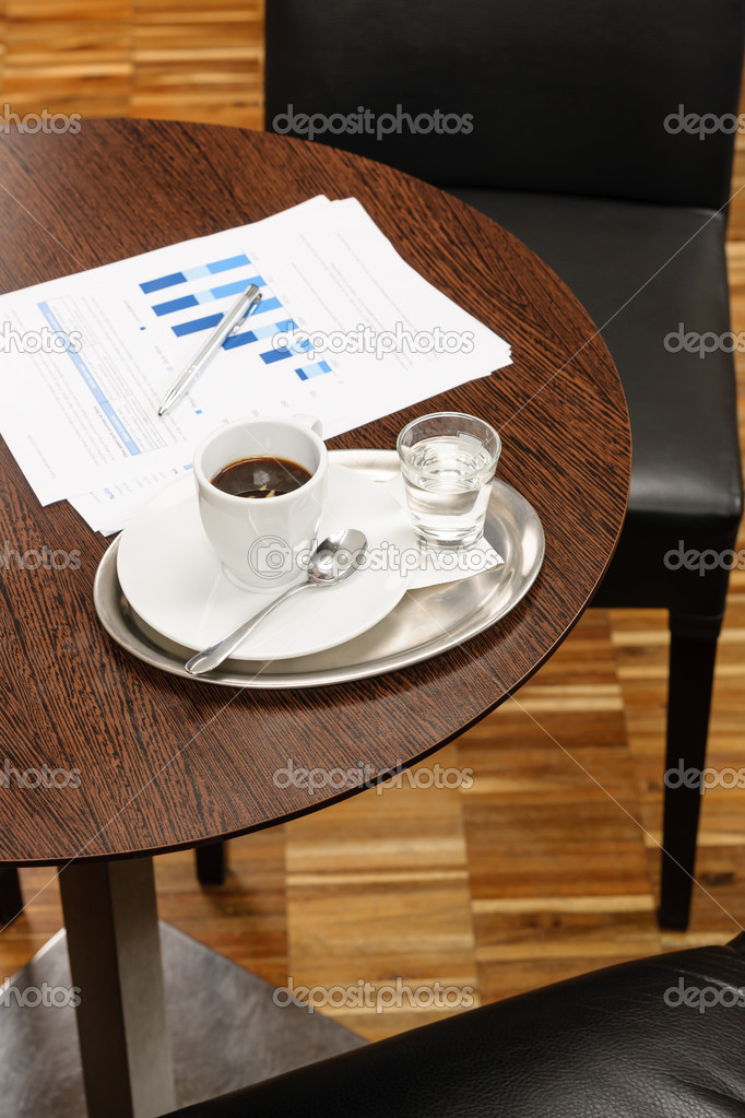 Coffee break report charts on table business meeting — Stock Photo #10220832