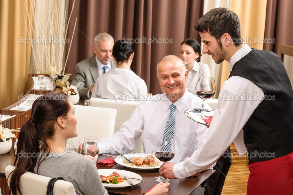 Young waiter serve wine to business at professional restaurant — Stock Photo #10221119