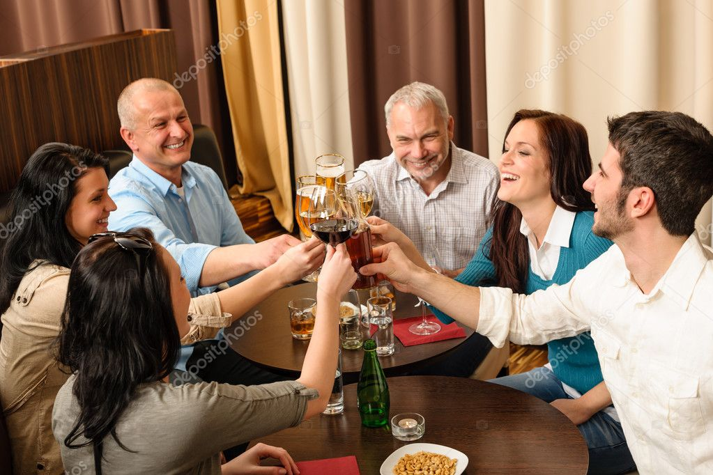 Drink after work business toasting at restaurant have fun  Stock Photo #10221189