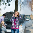 Car breakdown couple calling for road assistance — Stock Photo #10234593