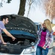 Car breakdown couple calling for road assistance — Stock Photo #10234601
