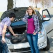 Foto de Stock  : Car breakdown couple calling for road assistance
