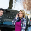 Car breakdown couple calling for road assistance — Stock Photo #10234617