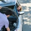 Car troubles couple starting broken vehicle — Stock Photo #10234629