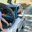 Car troubles couple starting cables vehicle — Stock Photo