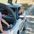 Car troubles couple starting cables vehicle — Stock Photo #10234636