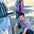 Stock Photo: Car wheel defect man change puncture tire