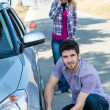 Car wheel defect man change puncture tire - Stock Photo