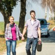 Out of gas couple need petrol car — Stock Photo #10234738