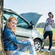 Stock Photo: Car defect two women waiting for help