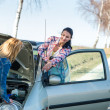 Stock Photo: Starting broken car two women have problems