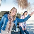 Car defect two women wait for help — Stock Photo