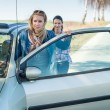 Pushing car technical failure two young women — Stock Photo #10234879