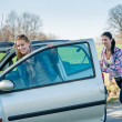 Stock Photo: Pushing car technical failure two young women