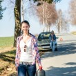 Out of gas woman need petrol car — Stockfoto