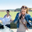 Two women lost on road call help - Stock Photo