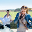 Stock Photo: Two women lost on road call help