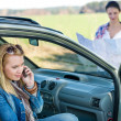 Stock Photo: Lost with car two women call help