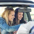 Stock Photo: Road trip car lost women search map