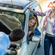 Car defect man helping two female friends — Stock Photo
