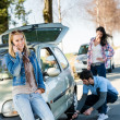 Broken wheel mhelping two female friends — Stock Photo #10235065