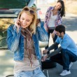 Wheel defect man helping two female friends - Stock Photo